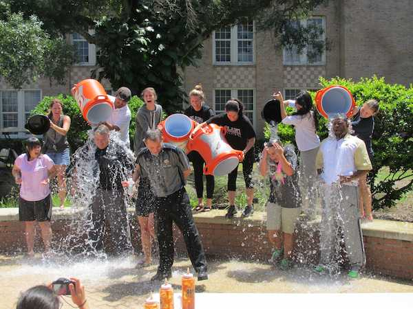 Cold water rushes over administration in the courtyard. The Challenge was done on Aug. 18 a the teachers' back-to-school barbecue.
