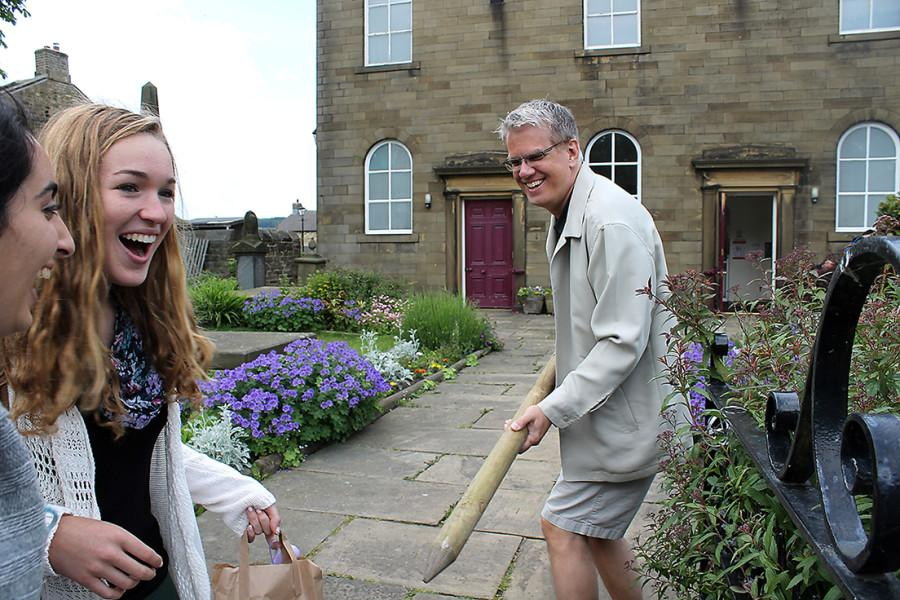Mr. Thomas chases Rojeen Falasiri (left) and Rachel Goding (right) through an English churchyard after a tour of the town of Haworth. Mr. Thomas, accompanied by Mrs. Sharpe and Mrs. Glenn, took a trip to England and Ireland with a group of his students this past summer, exploring the inspiration for many famous literary works such as Wuthering Heights.
