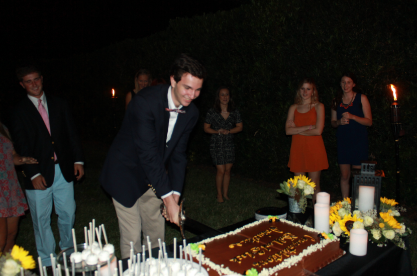 Sergeant at arms Chip Stern performs the cake cutting ceremony with the Gold and Black sword.