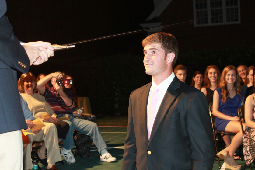 Jake Bak is knighted into the Order of the Gold and Black