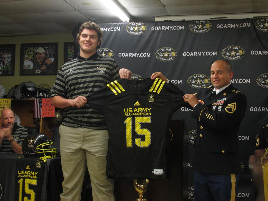 Jake+Frumorgen+will+play+in+the+U.S+Army+All-American+Bowl.+Fruhmorgen+was+presented+with+a+hat+and+a+jersey+during+the+ceremony.