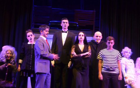 "The entire Addams Family takes their place on stage. ""I had a wonderful performance, playing Lurch, and can't wait to do it again,"" junior Harrison Reed, who played the lengthy zombie butler said."