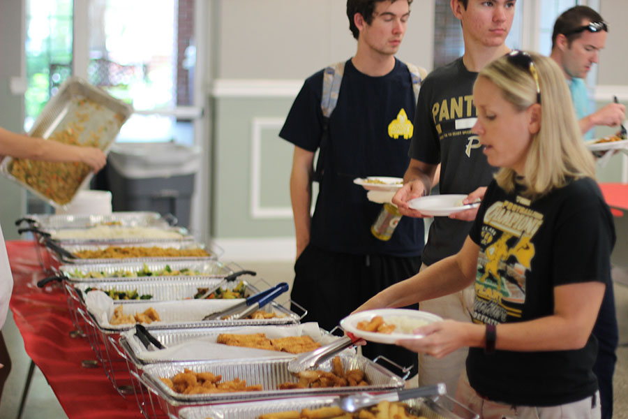Scooping Chinese food on to her plate, Science teacher Lindsey Tait takes part in the Gold Card lunch.