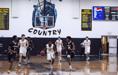 Boys basketball beats Robinson