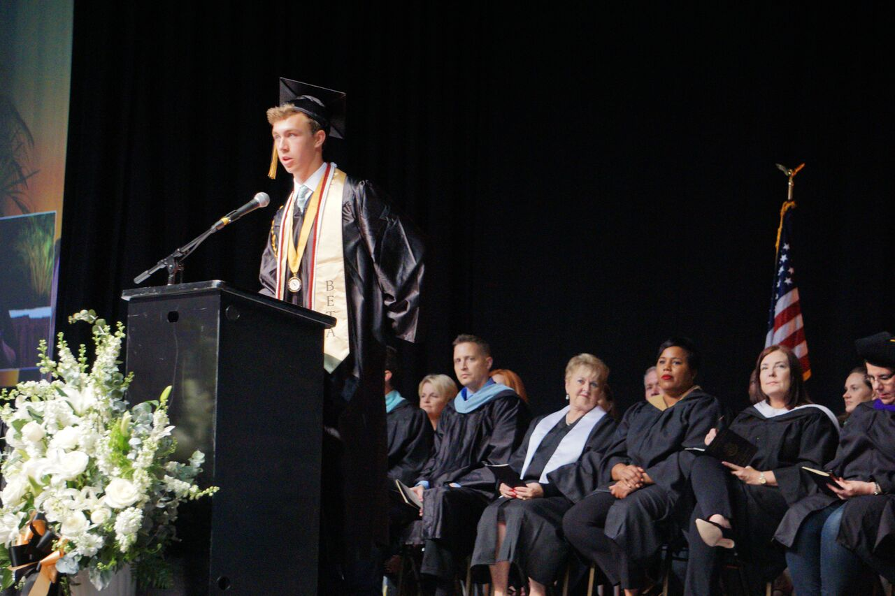 At the Plant High School graduation ceremony for the class of 2019, Senior Class president Jack Schifino stands at the podium to give a speech to his class looking back at their time as a Plant High School student and their future after graduation on May 21 at the Florida State Fair grounds.