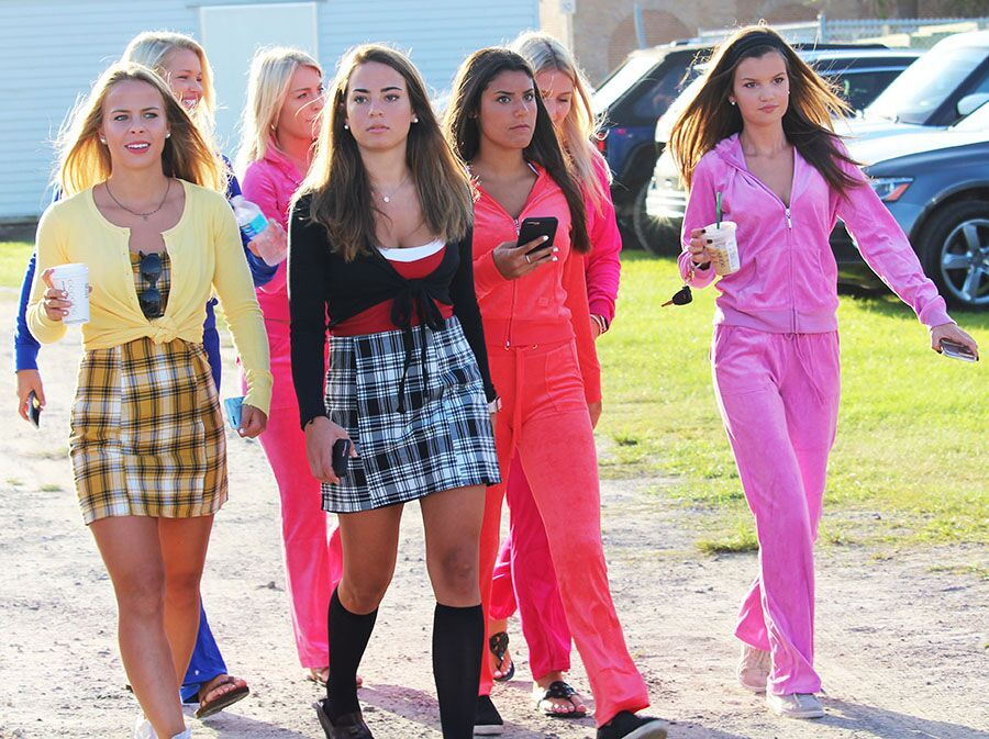 Walking+onto+campus%2C+seniors+Ansley+Melendi%2C+Shannon+Snyder%2C+Stephanie+Ross+and+Avery+Slack+arrive+clothed+in+%22Clueless%22+costumes+and+track+suits+to+fit+the+early+2000s+theme.