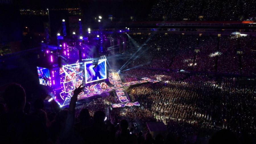 In+front+of+50%2C000+fans+Taylor+Swift+sings+her+Billboard+hit+%E2%80%9CLove+Story%E2%80%9D+on+Aug.+14+at+Raymond+James+Stadium.+As+fans+sang%2C+their+light+up+bracelets+were+glowing+the+dark.