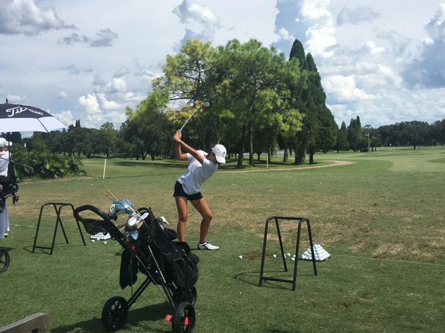 Playing at Buckhorn Springs, sophomore Annika Johnson takes a swing Aug 20. Johnson shot a 55, assisting in the team's win against Freedom and Robinson high schools.