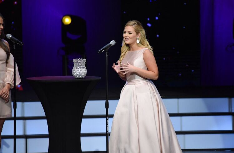 At the Miss Tampa Teen USA pageant, senior Emerson Ward answers an onstage question which topics range from bullying and drug problems to immigration and leadership qualities. Pageant coaches helped her prepare for discussion questions after winning her first pageant last March.