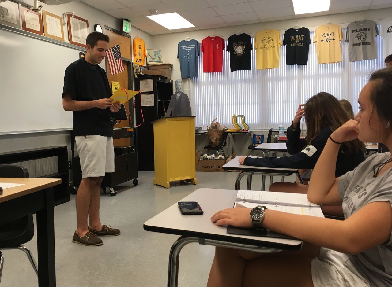 "Presenting to his AP U.S. History class, junior Will Neely warns classmates about the consequences of substance abuse Oct. 19. Members of the Students Against Destructive Decisions club told similar stories throughout the day as a part of their ""Grim Reaper Day."""