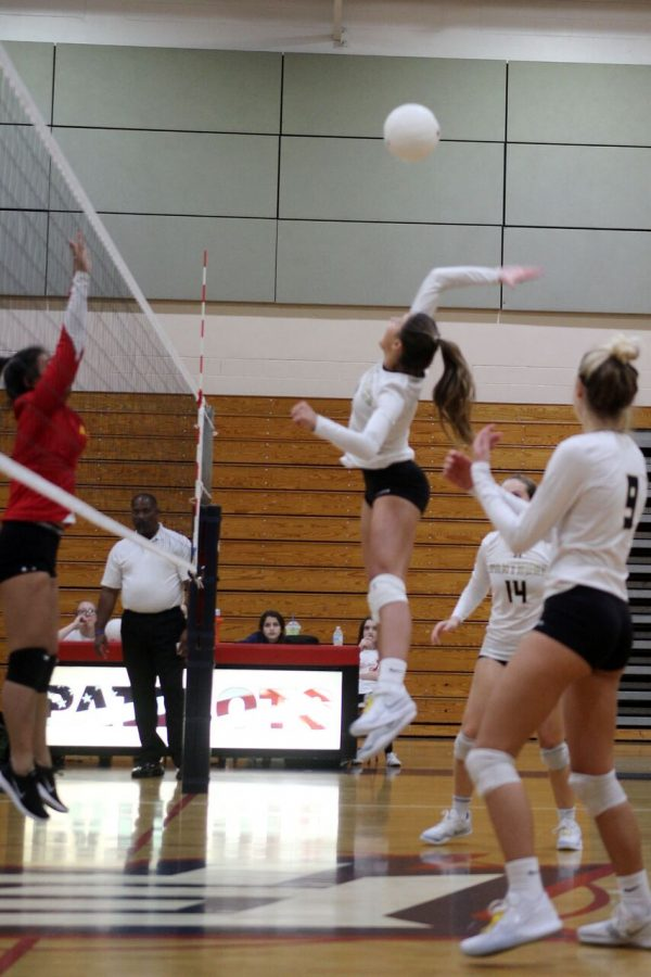 Spiking the ball, junior Grace Blanco jumps to aim downward on the Leto High School side of the court at Freedom High School Oct. 15. The game finished 3-0, allowing them to progress to the district semifinals.