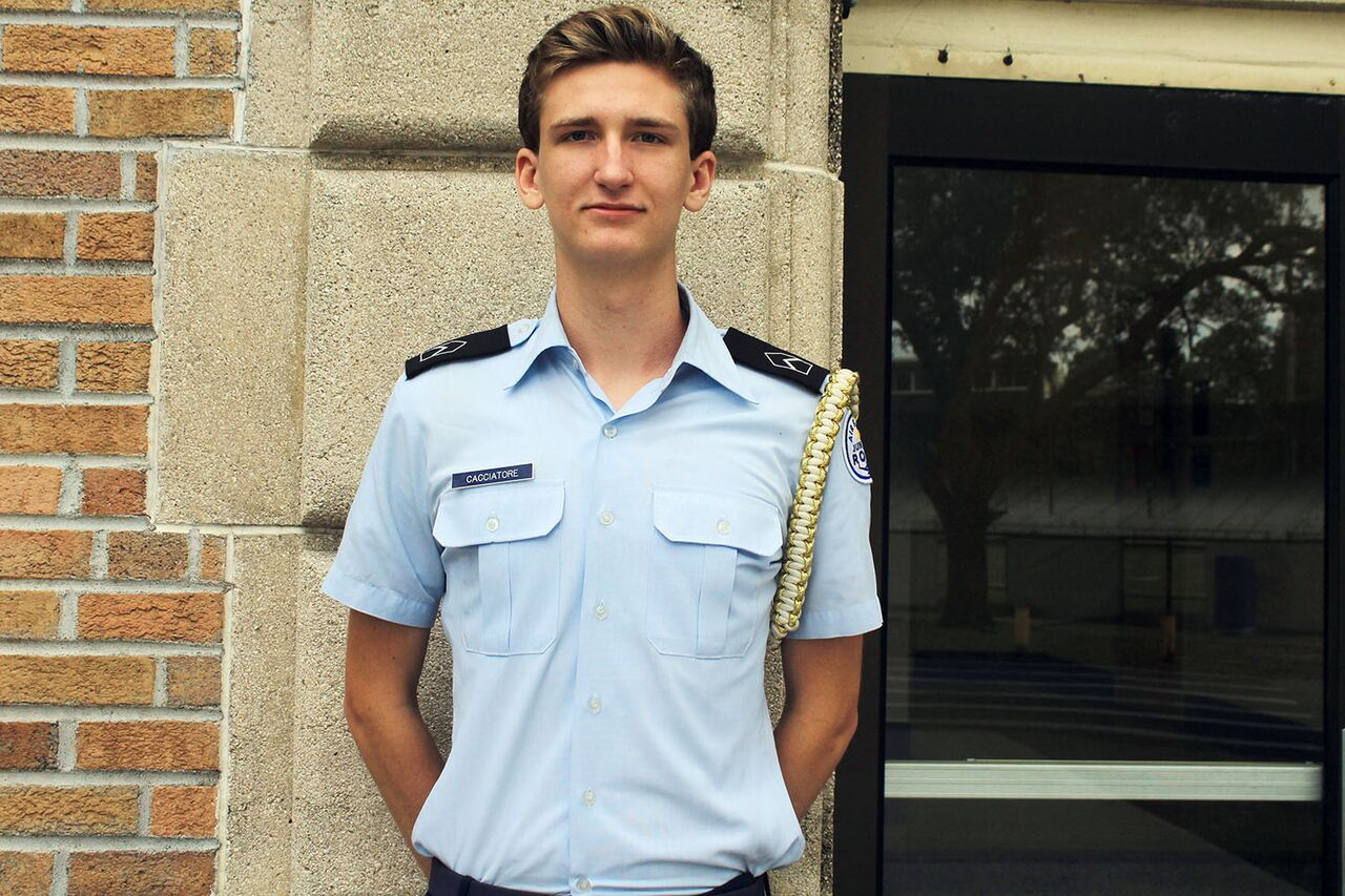 Becoming involved in ROTC at the beginning of his high school career, junior Joseph Cacciatore learns about his position's responsibilities, as well as helping newer color guard and drill members learn too.  Color guard commander Cacciatore said that the main goal of ROTC is to promote citizenship at the school.