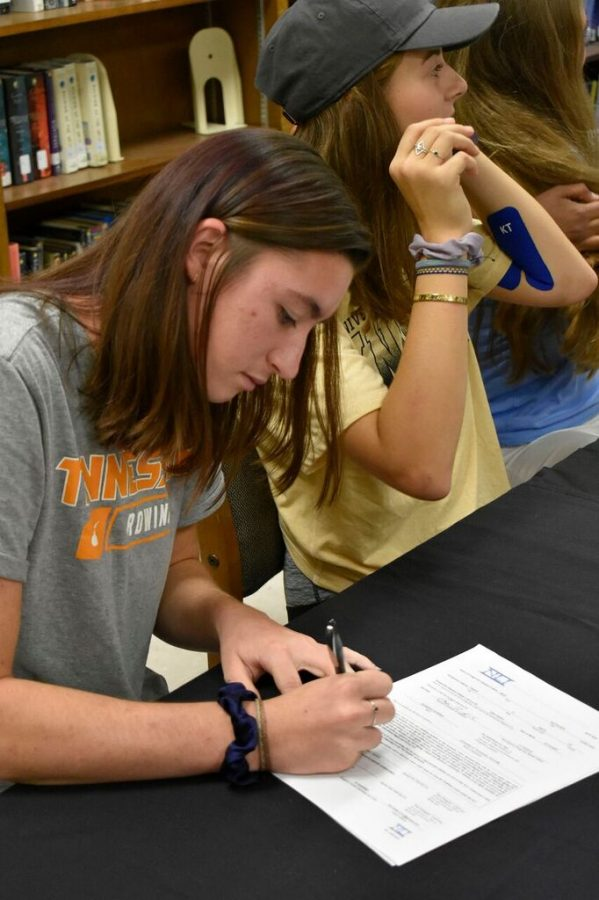 After coach Lauren Moseley introduces her athlete, senior Kathleen Rice signs the National Letter of intent Nov. 14 at the media center. Rice signed to the University of Tennessee for crew.