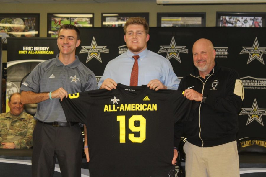 Four-star+senior+offensive+lineman+William+Putnam+stands+in+front+of+his+teammates+as+the+U.S.+Army+All-American+Bowl+representative+presents+him+his+jersey+for+the+U.S.+Army+All-American+bowl+game.++Putnam+was+selected+as+one+of+the+top+100+senior+football+players+in+the+nation+and+will+partake+in+the+U.S.+Army+All-American+Bowl+game+Jan.+5+in+the+Alamodome+in+San+Antonio.+