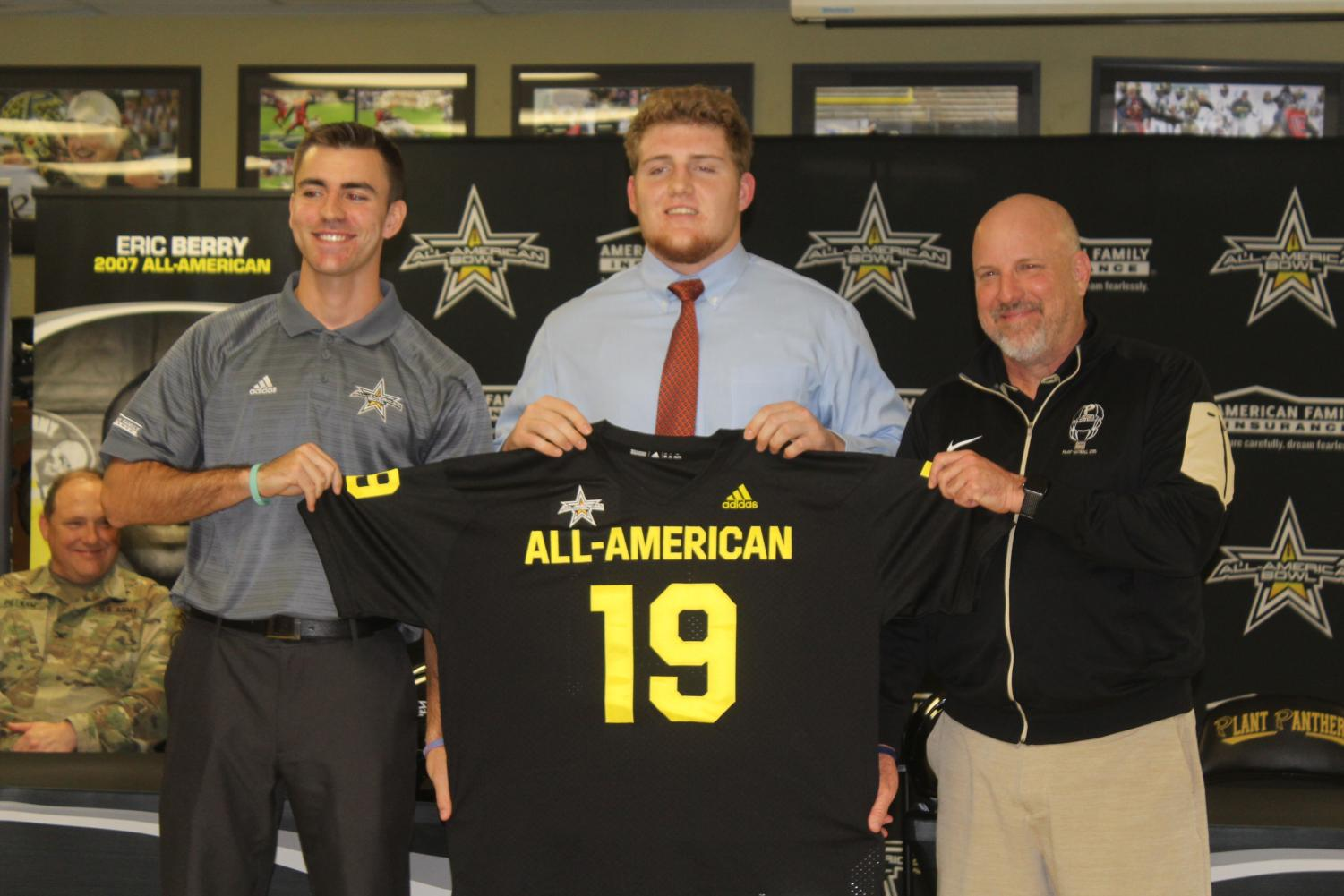 Four-star senior offensive lineman William Putnam stands in front of his teammates as the U.S. Army All-American Bowl representative presents him his jersey for the U.S. Army All-American bowl game.  Putnam was selected as one of the top 100 senior football players in the nation and will partake in the U.S. Army All-American Bowl game Jan. 5 in the Alamodome in San Antonio.