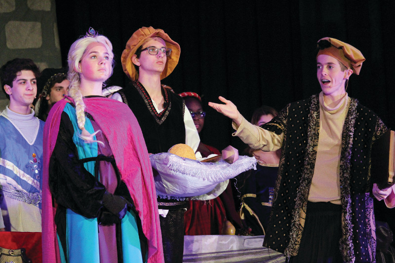 "Following the song for ""For the First Time in Forever,"" juniors Katie Vincent, Matthew VanWert and Parker Shaw perform the coronation scene from Hans Christian Andersen's ""The Snow Queen"" Nov. 29 in the St. Mary's Episcopal Day School auditorium. Vincent played the character of Elsa, VanWert played the narrator and Shaw played the page."