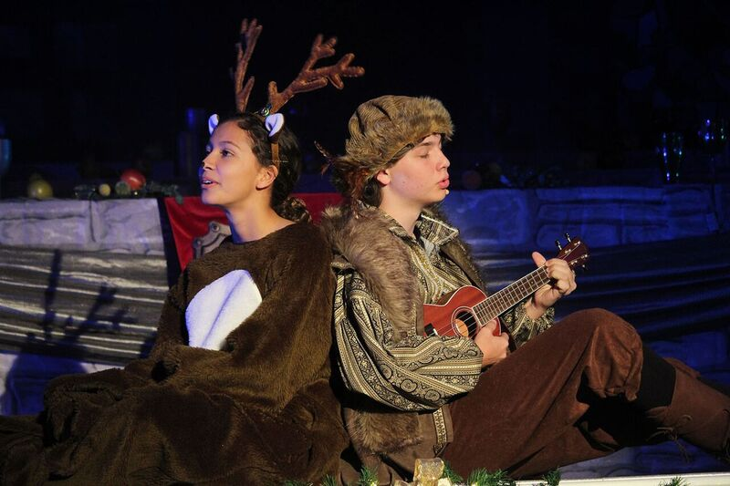 "Performing the song ""Reindeers are Better than People,"" seniors Charlie Yost and Maya Gonzalez portray the characters of Kristoff and Sven in the St. Mary's Episcopal Day School auditorium Nov. 29. This scene was followed by the introduction of Olaf the snowman with the song ""In Summer"" from Hans Christian Andersen's ""The Snow Queen."""