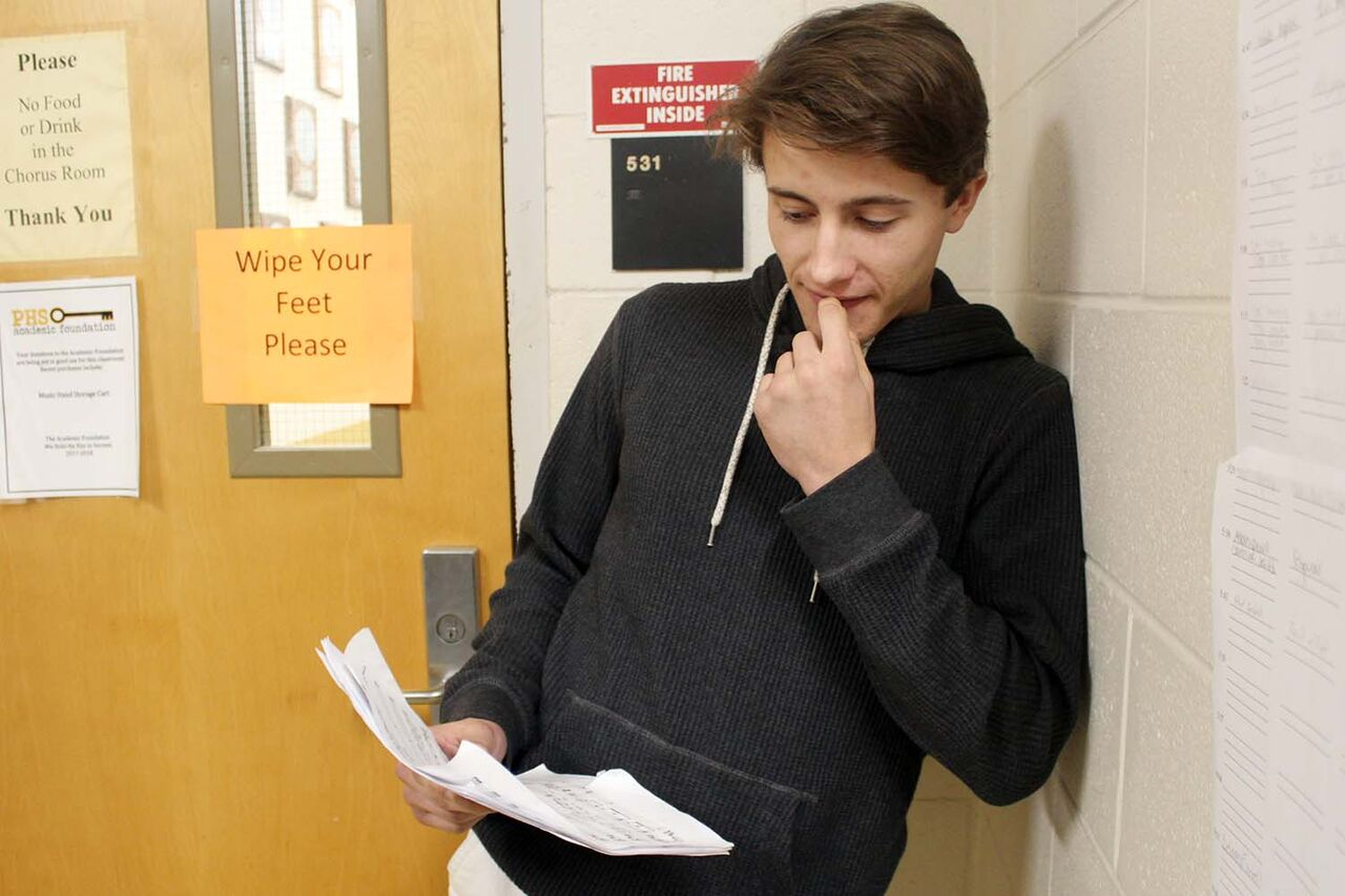 Minutes before his audition for Rick's Café, senior Hamilton Reese studies the sheet music for his song Jan. 10 in the music hall. Reese auditioned in a trio with junior Camden Collins and senior Caitlyn Dellegatto.