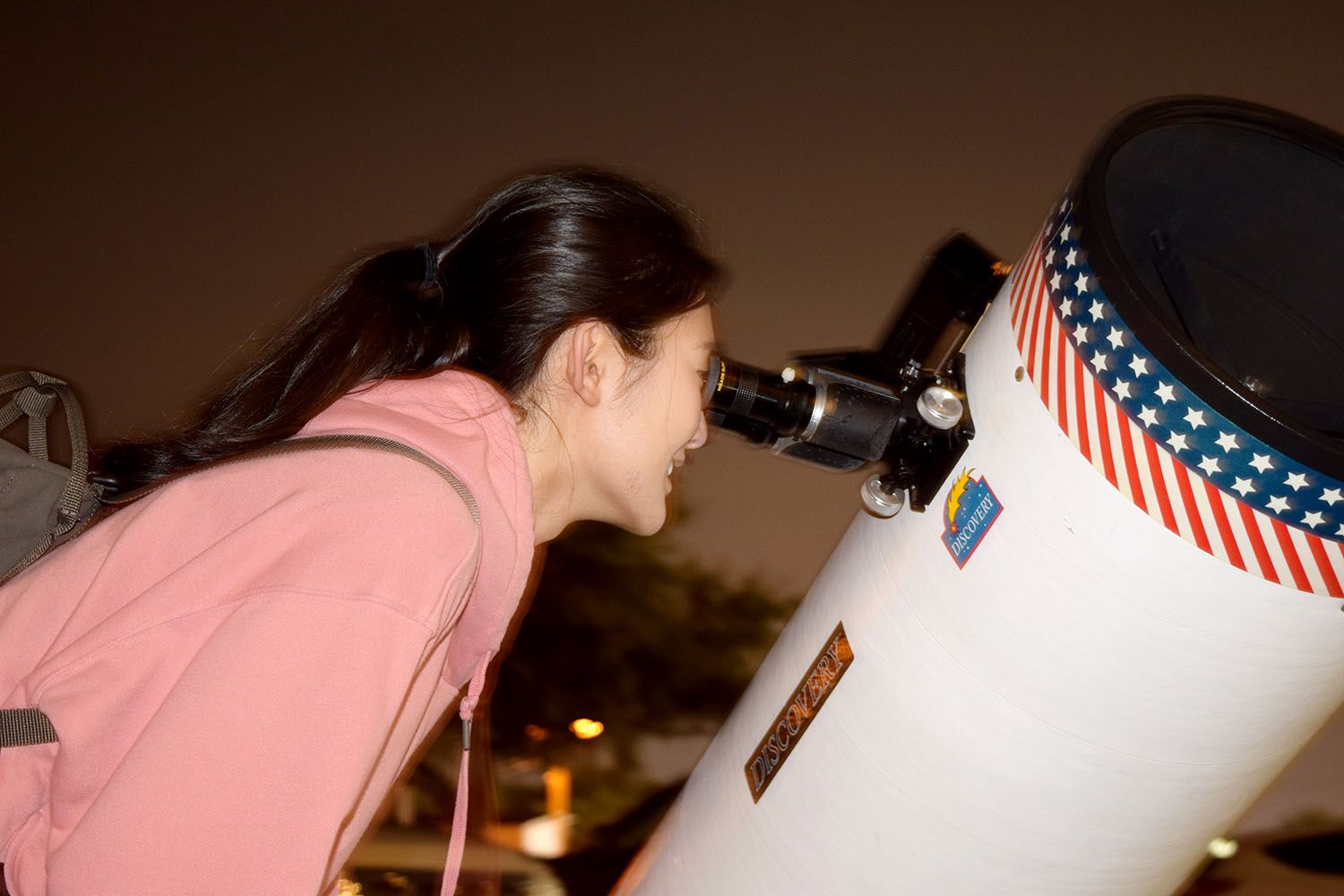 Gazing at a star, senior Ashley Cha studies the different textures and colors in the student parking lot Jan.15. The light coming off the star observed takes 14,000 years to reach earth.
