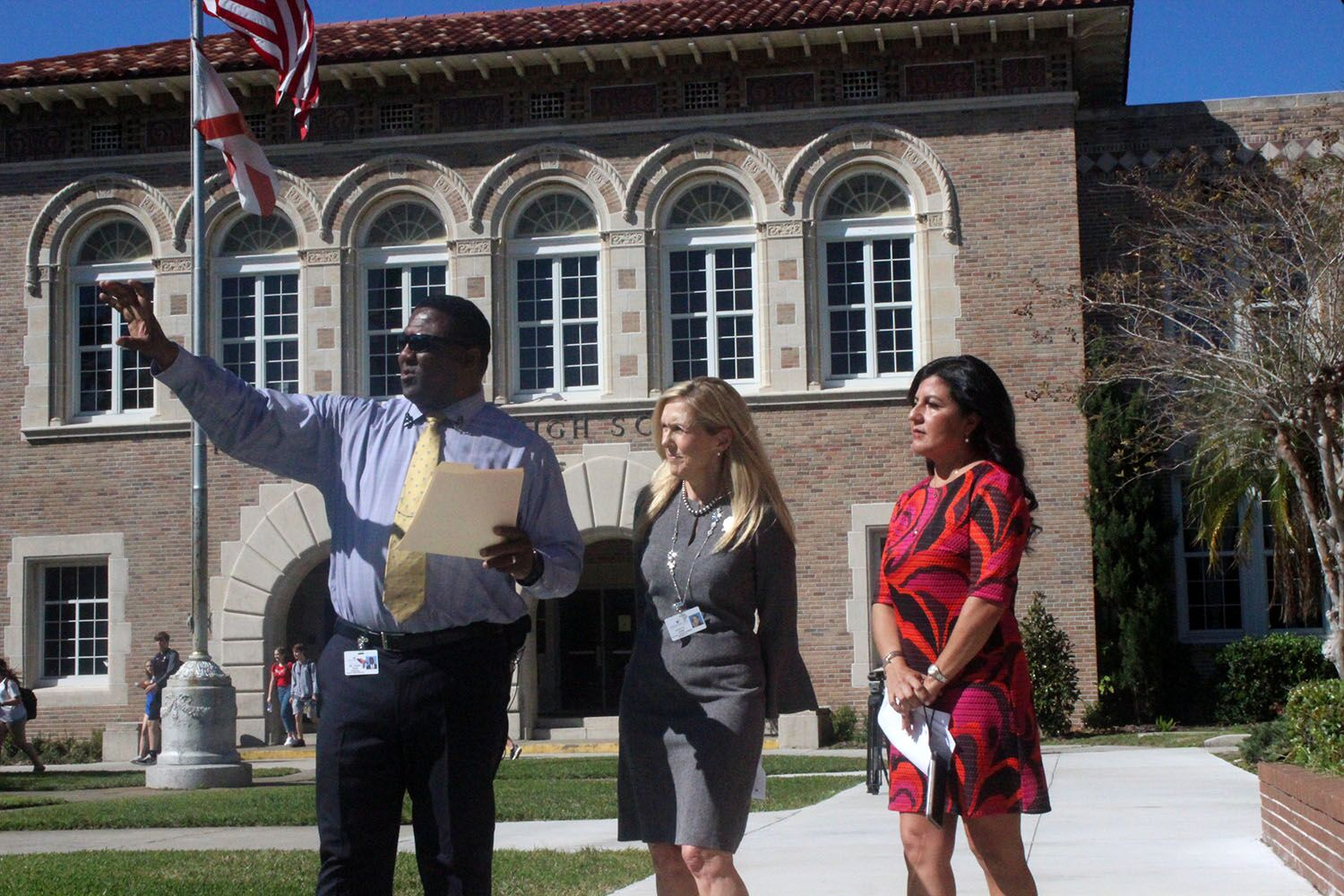 Speaking with school board member Stacy Hahn and state representative Jackie Toledo, Principal Johnny Bush gives a tour of the new security implements  Feb. 11. Bush pointed out the new locking gates with a buzzer system and 33 security cameras placed around school.