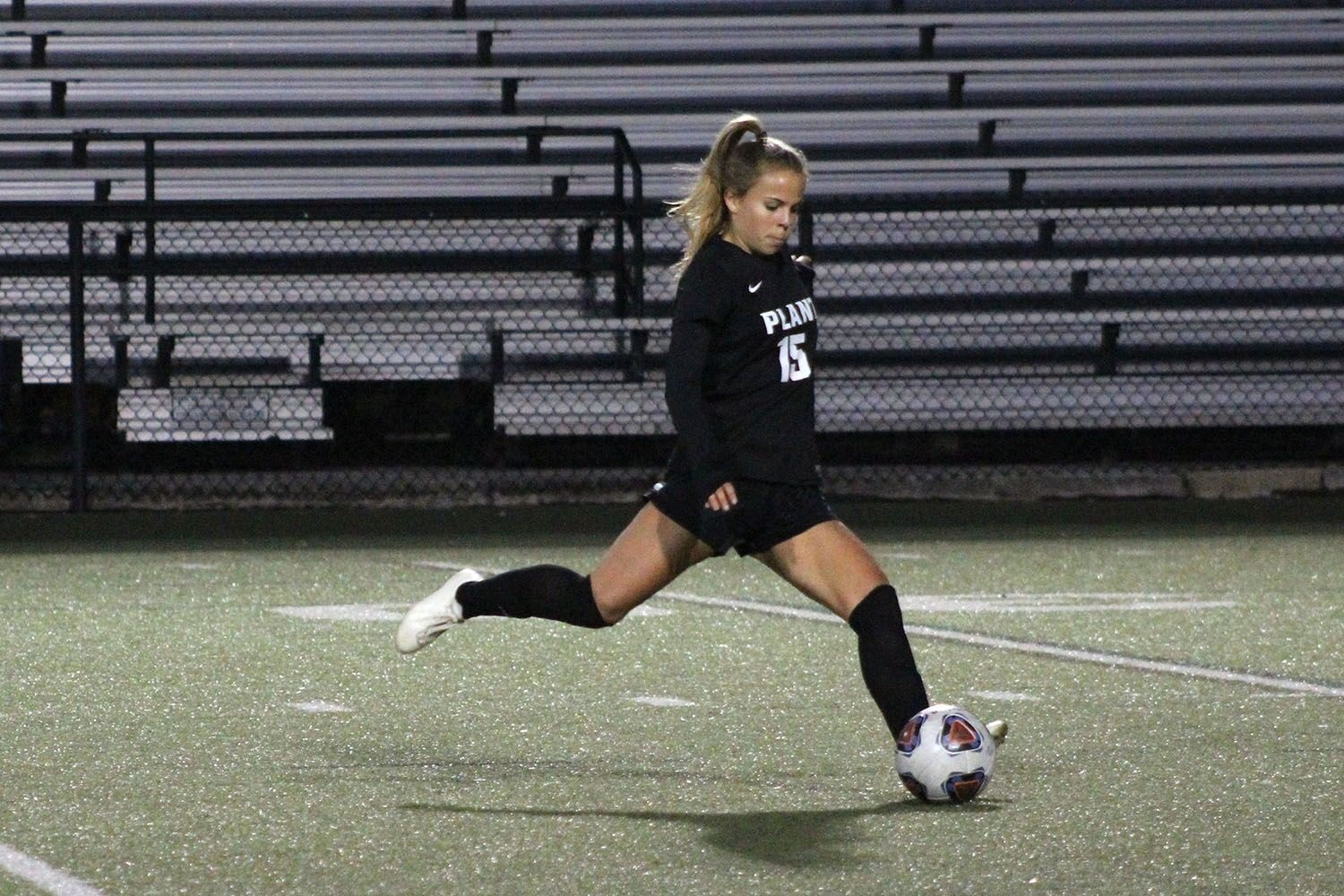 Passing the ball, senior captain Ansley Melendi looks for an open teammate Jan. 15 at Dad's Stadium. It was the annual senior night game where the teammates said goodbye to their senior teammates.