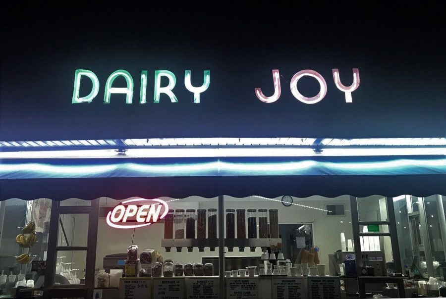 The+storefront+of+Dairy+Joy+is+lit+up+so+oncoming+drivers+will+stop+for+a+quick+ice+cream.+After+transferring+ownership%2C+the+sign+and+menus+were+changed+by+Chris+and+Karrie+Lynn+Mueller.