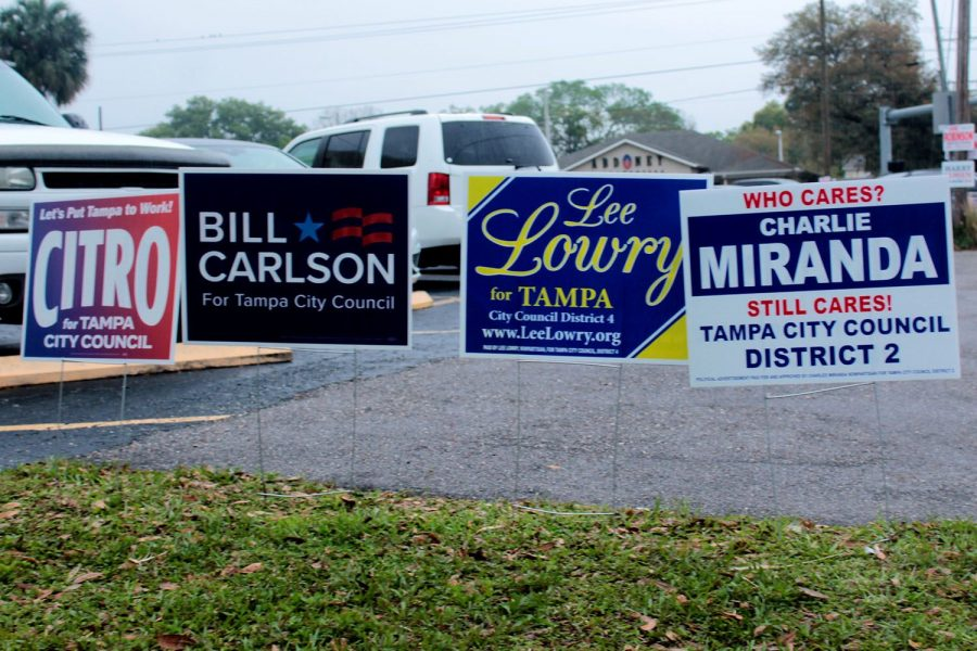 Candidates%27+signs+stand+at+the+Palma+Ceia+United+Methodist+Church+March+5.+Seven+candidates+campaigned+for+mayor+for+nearly+a+year+before+voting+day.+