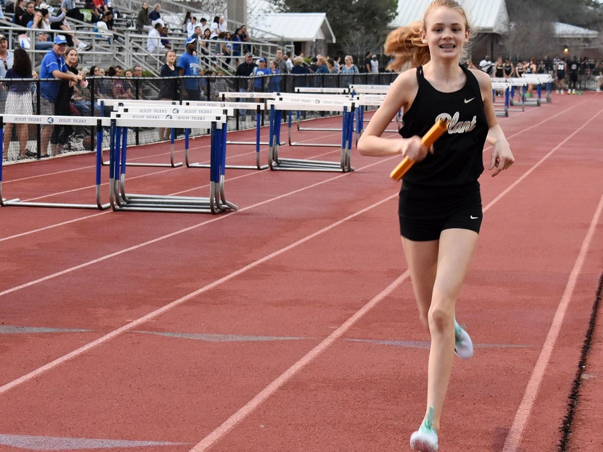 Going onto her second lap, freshman Mary Ellen Eudaly runs the 4x800 at the Jesuit Tri-Meet Feb. 12. She also ran the mile later that night, winning the event in a personal-record of 5:05.
