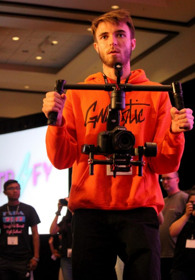 Filming the crowd at the Opening Ceremony in the Palm Ballroom at the Wyndham hotel, a contestant uses a stabilizer on his camera as an aid. A record 1400 students attended the 2019 spring FSPA.