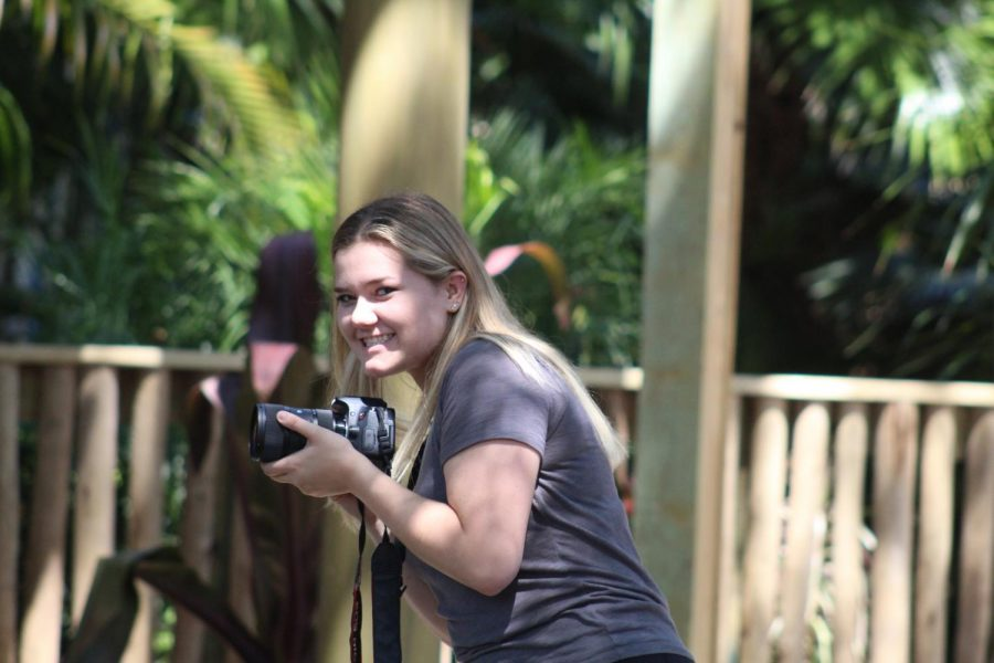 In between filming, senior Alea Jennings grins at the camera while covering Tigris, the new rollercoaster at Busch Gardens. It was one of the first times she made a video, and it was viewed 93 times on the Pep O Plant youtube channel.