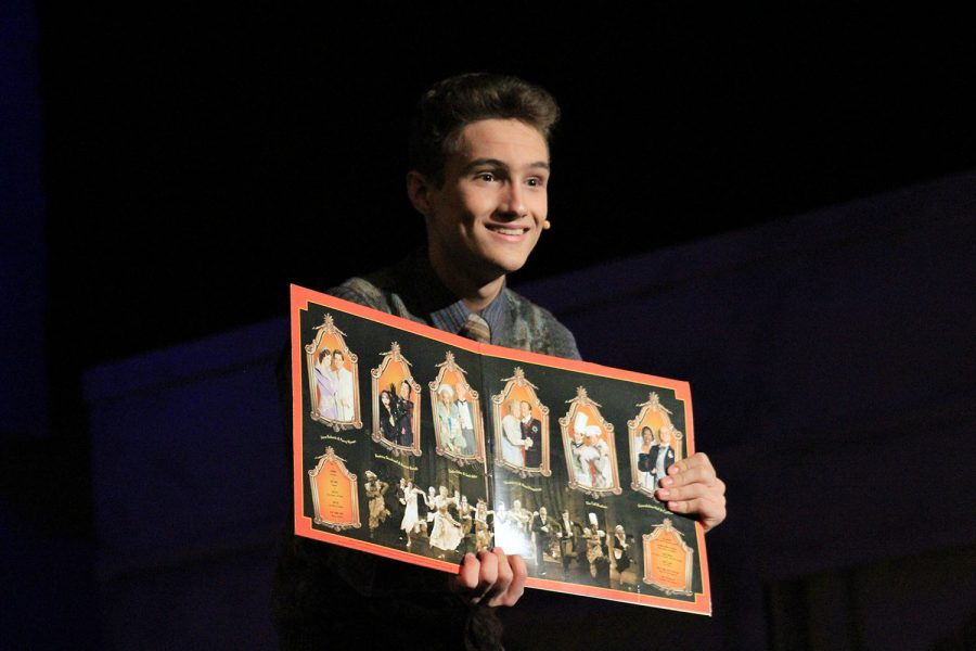 Introducing+the+cast%2C+sophomore+Cameron+Summit+shows+off+his+Drowsy+Chaperone+record+in+the+auditorium+April+5.+Summit+played+the+role+of+the+Man+in+Chair+who+narrated+the+show.+