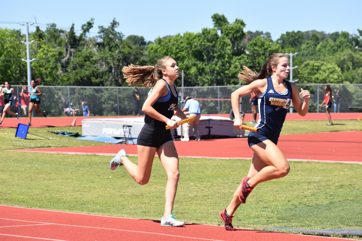 Keeping+her+eyes+on+the+runner+ahead%2C+junior+Elizabeth+Eudaly+sprints+her+last+lap+of+the+4x800+at+regionals+April+27+at+George+Jenkins+High+School.+Eudaly+raced+another+800-meter+later+in+the+day%2C+finishing+third+and+qualifying+for+states.+