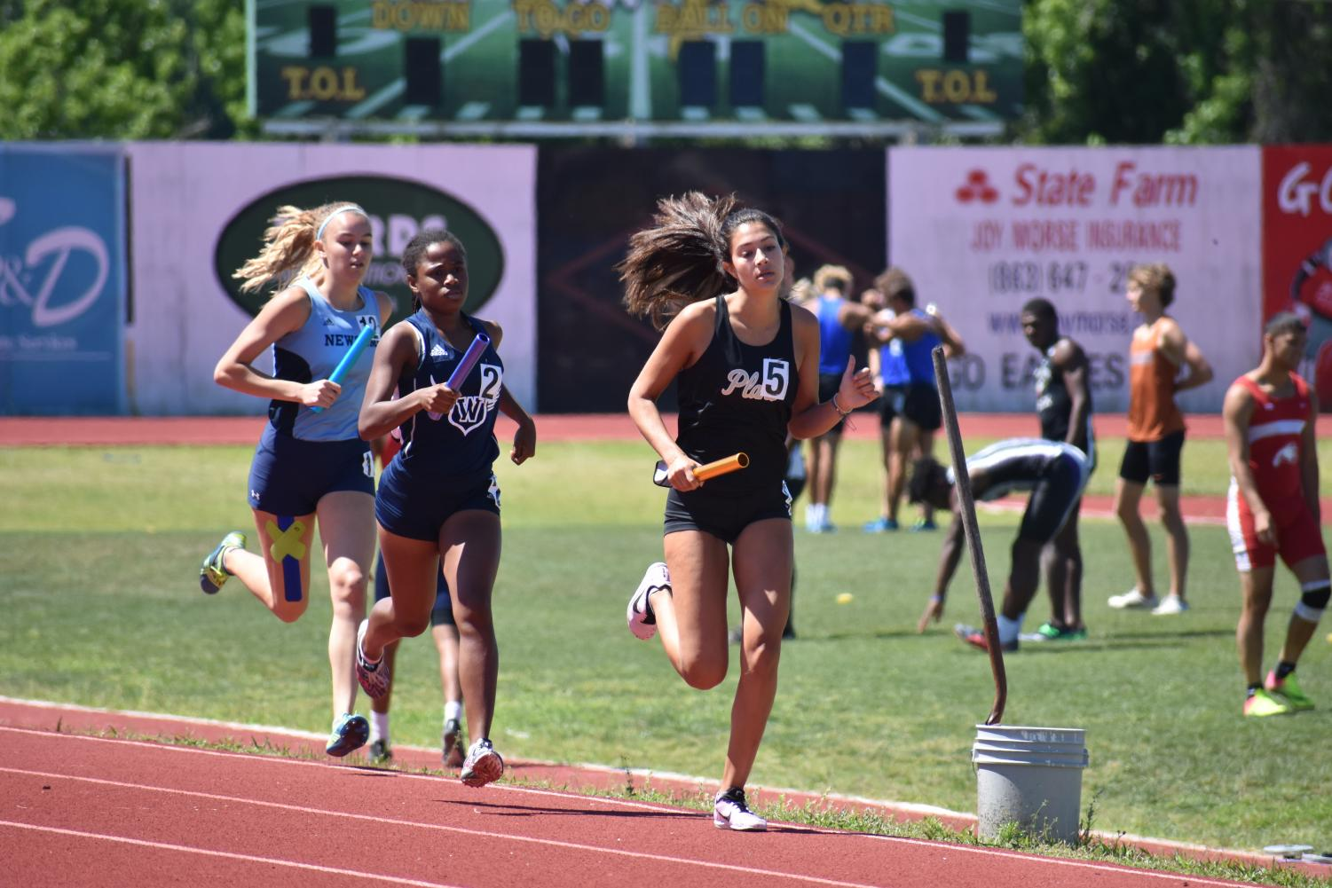 Creating+a+gap+from+her+opponents%2C+freshman+Arlie+Rubin+approaches+the+last+200+meters+of+her+race+April+27+at+George+Jenkins+High+School.+The+4x800+team+qualified+for+states+with+a+time+of+9%3A30.+
