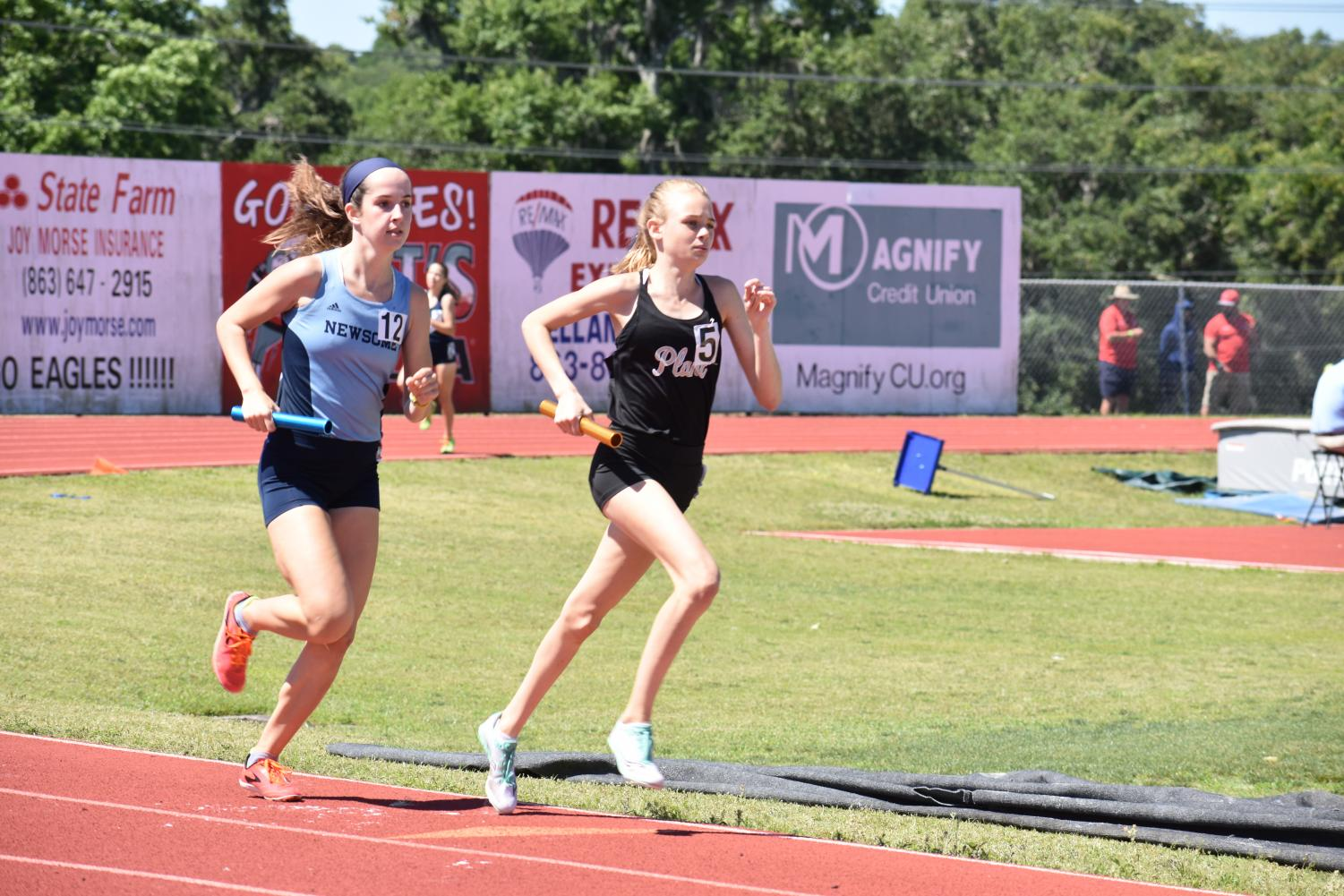 Keeping+her+eyes+up%2C+Mary+Ellen+Eudaly+sprints+down+the+straightaway+in+the+4x800+relay+at+regionals+April+27+at+George+Jenkins+High+School.+Eudaly+also+raced+the+3200-meters+and+1600-meters+at+regionals+and+qualified+for+states+in+both+events.+