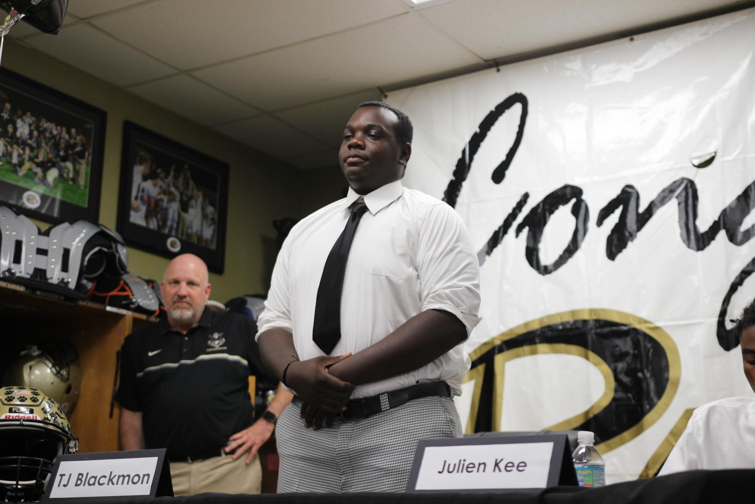 Standing+in+front+of+family+and+friends%2C+senior+lineman+TJ+Blackmon+announces+his+college+decision+April+17+in+the+field+house.+Blackmon+will+be+attending+Webber+International+University+next+fall.+%0A