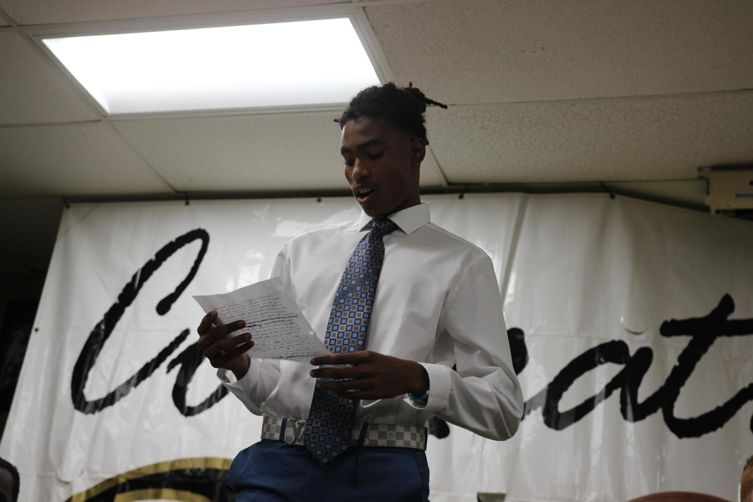Reading+a+speech+he+wrote%2C+senior+defensive+back+Juilen+Kee+addresses+the+crowd+gathered+April+17+in+the+field+house+for+signing+day.+Kee+has+yet+to+make+the+decision+on+where+he+will+be+attending+school+next+fall.+