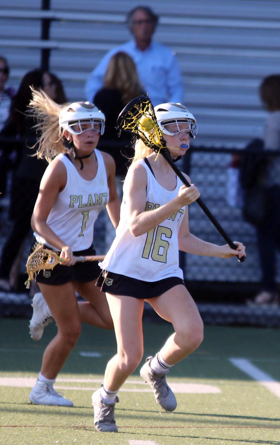 Running+downfield%2C+freshman+Ashley+Quinn+looks+for+an+open+shot+April+2+at+Dad%E2%80%99s+Stadium.+The+girls+varsity+lacrosse+lost+to+Berkeley+High+School+7-6.+