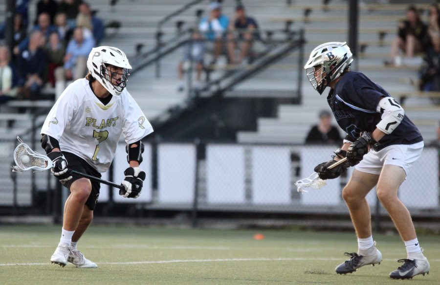 Going+one-on-one+with+the+defense%2C+sophomore+Christian+Murphy+makes+a+move+to+pass+the+defender+April+2+at+Dad%E2%80%99s+Stadium.+Murphy+joined+the+boys+varsity+lacrosse+team+his+freshman+year.+