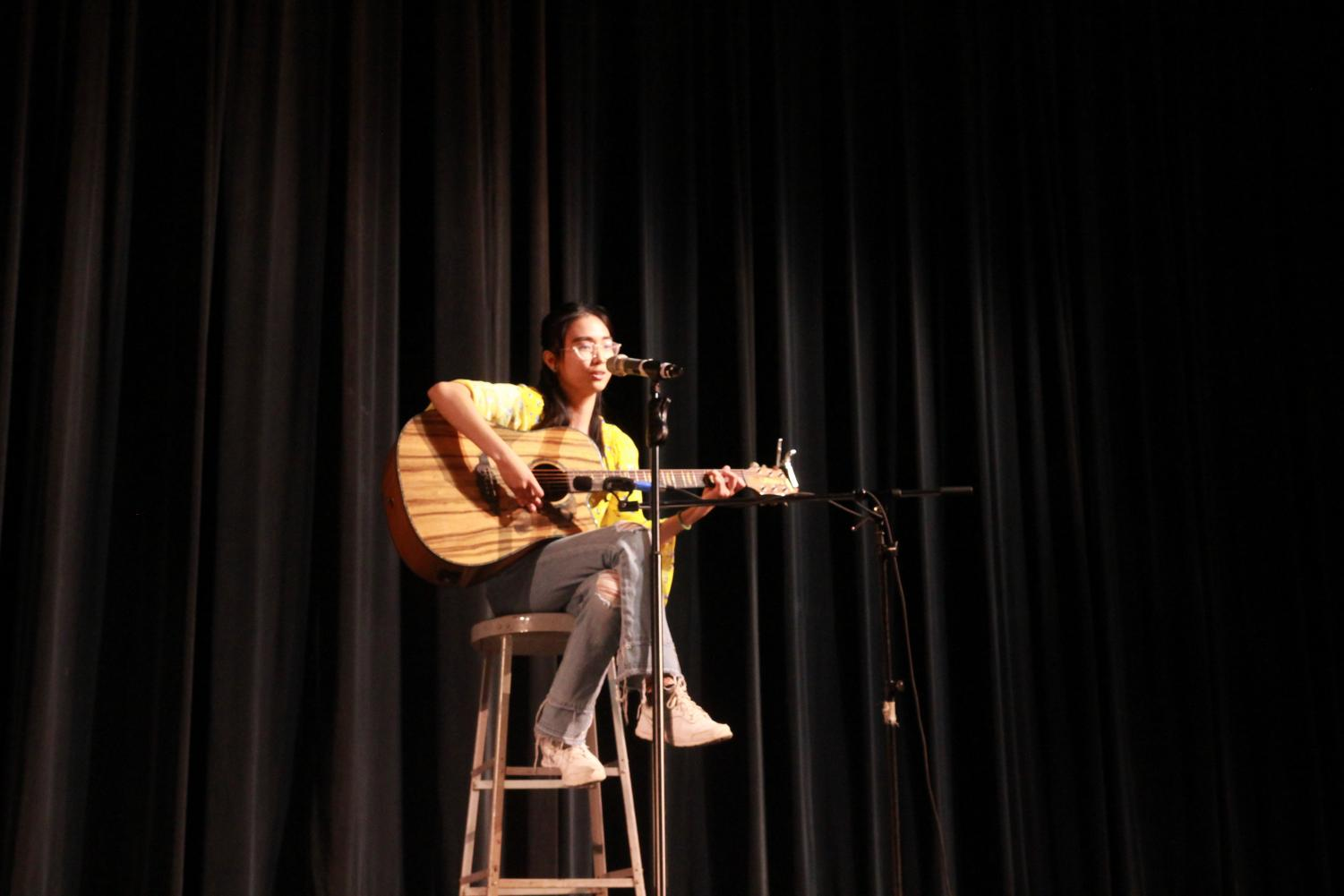 Strumming+her+guitar%2C+junior+Reian+Beltran+sings+in+the+auditorium+April+23.+Beltran+sang+Brave+by+Sara+Bareilles%2C+and+said+she+chose+to+sing+the+song+%E2%80%9Cbecause+it+was+about+speaking+about+how+you+feel+and+not+caring+what+other+people+think+and+encouraging+others.%E2%80%9D