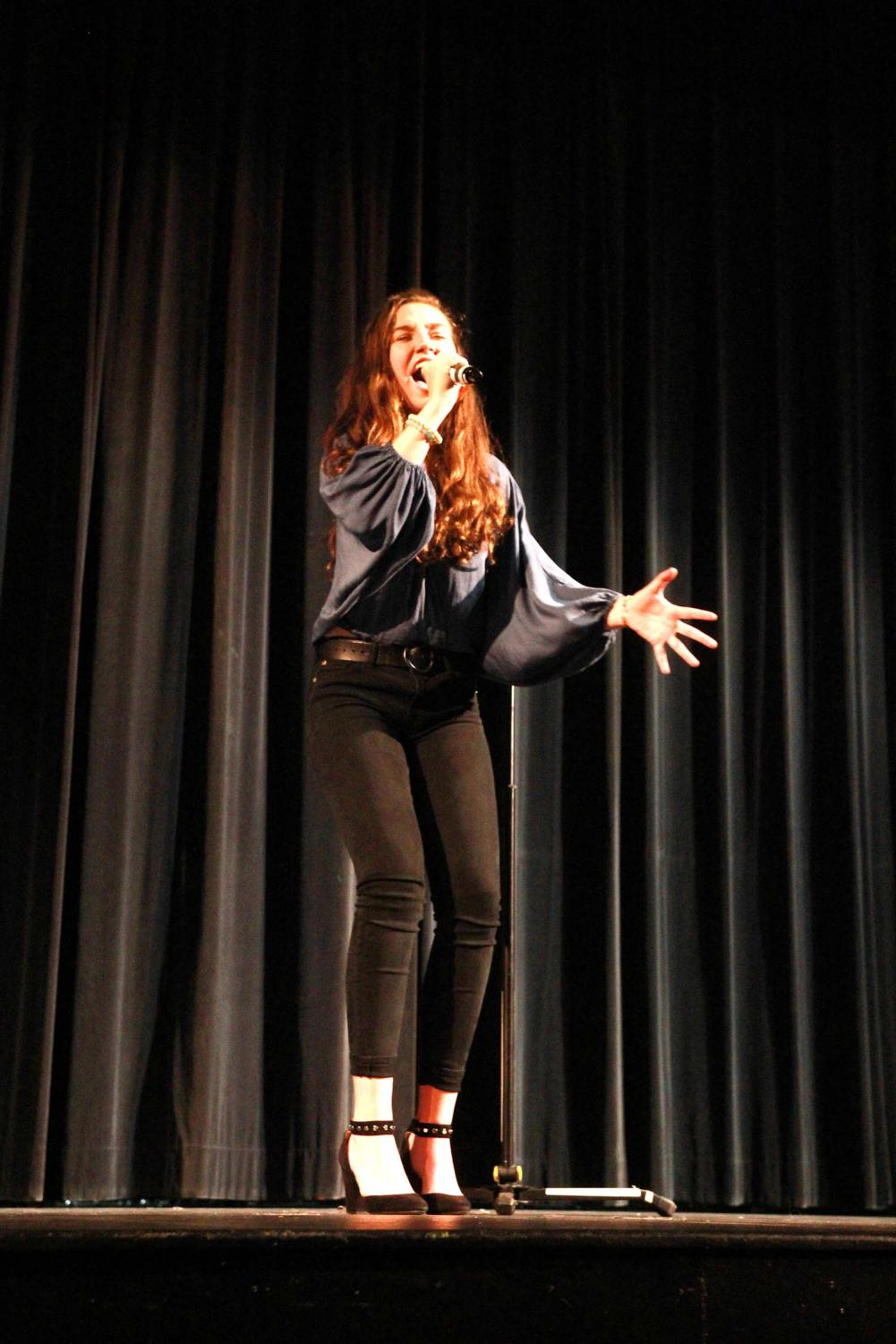 Deep+into+her+performance%2C+sophomore+Avery+Franks+sings+Against+All+Odds+by+Phil+Collins+in+the+auditorium+at+Be+the+Voice+April+23.+Franks+got+second+place+in+the+competition+and+won+a+fifty-dollar+gift+visa+card.