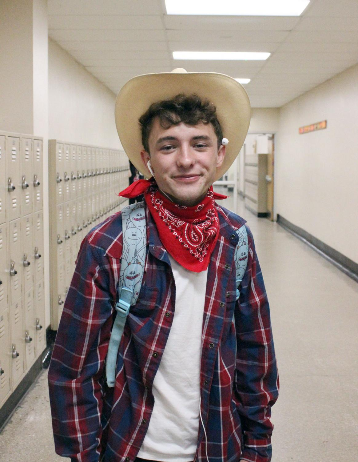 Posing+as+a+cowboy%2C+senior+Mark+Griffiths+wears+a+cowboy+hat+Wednesday%2C+May+1+for+senior+week.+Thursday%E2%80%99s+theme+was+%E2%80%9CSenior+Citizen+Day.%E2%80%9D+