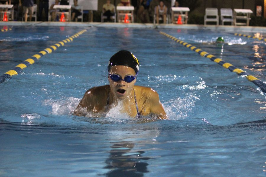 Mid-stroke, junior Maggie Rowan swims breaststroke September 5 at Bobby Hick's pool. Breaststroke is Rowan's favorite event because she feels she does best in that event.