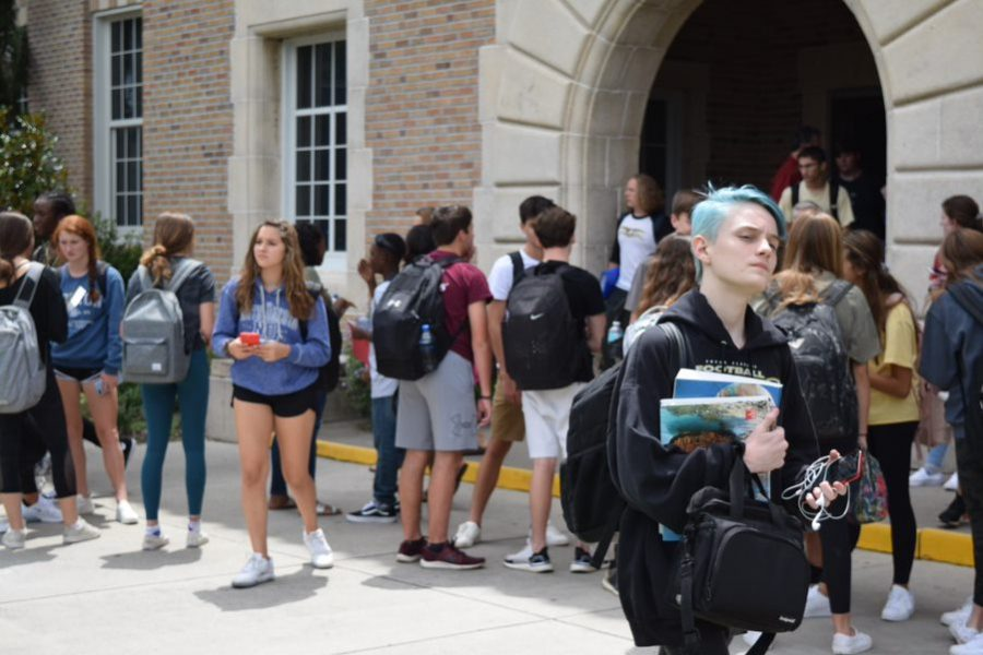 After the final bell, students exit the main hall August 20. The student body increased in size from last year, resulting in changes to guidance counselors and sports classifications.