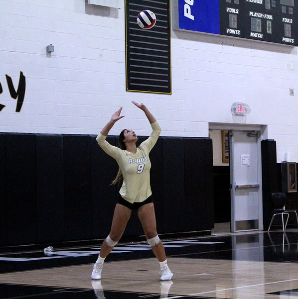 Mid-serve%2C+senior+Sam+Caglianone+starts+off+the+game+September+9+in+the+gym.+The+Plant+varsity+team+beat+Palm+Harbor+University+college+3-0.+
