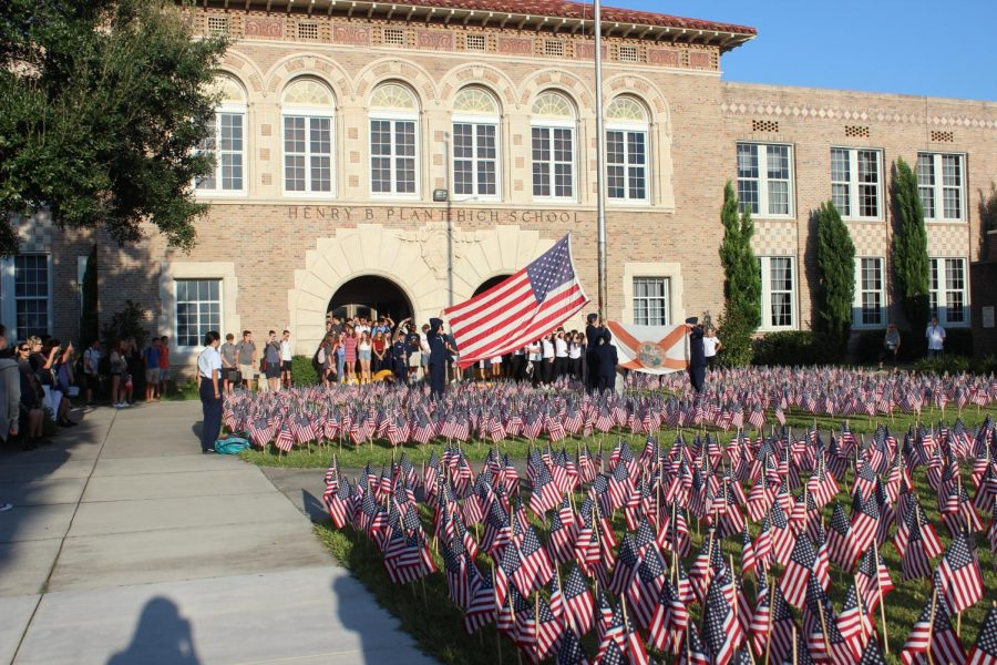 Around+2%2C977+flags+stand+on+the+front+yard+of+the+school+Tuesday+Sept.+10+in+honor+of+the+9%2F11+tragedy.+The+flags+represented+those+lives+lost+during+the+terrorist+attack+on+the+Twin+Towers.+