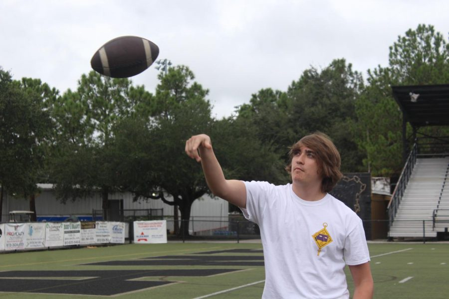 Throwing the ball, sophomore Cooper Ross has been playing defensive end for two years. Ross is in his second year on the JV football team.
