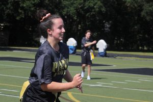 In the midst of a JROTC game of flag football, senior Kailee-Rose Casey runs down the field Sept. 27. Casey hopes to pursue veterinary medicine and is looking at the University of South Florida and Florida Southern College. Photo by Libby Gough and Kate Frier.