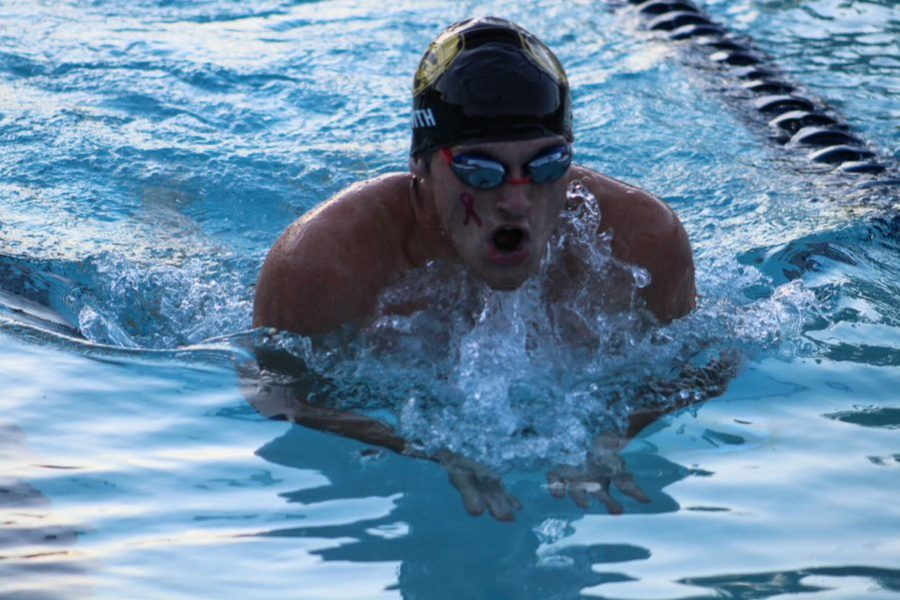 Swimming breaststroke, senior Max Smith participates in the Spike and Splash meet Wednesday Oct. 5 at the Academy of the Holy Names . Smith hopes to continue swimming until college, and says that it has helped shape him into a better person.