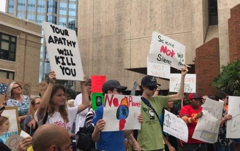 Protestors show supportfor their cause through protest. The climate change march had attendees from many different affiliations like March for Our Lives, and Green Gasparilla. Photo courtesy of Taylor Ward.