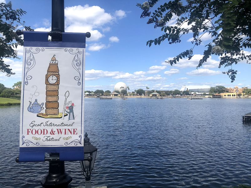 While visitors eat and walk, Epcot's lake is decorated with advertisements for the Epcot Food and Wine Festival. Epcot has been hosting the festival for 24 years and the event will continue through November 23.